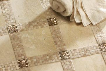 Travertine floors with mosaic and bronze inserts